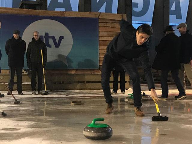 Visiongeek aims for victory during a curling match in Aspen Bocadero